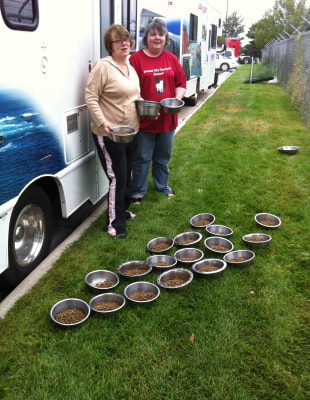 Image: Cyndi Flores and Terri Nigro preparing food for the dogs.