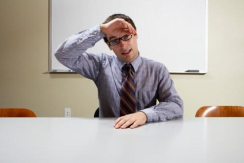 Nervous Businessman in Conference Room
