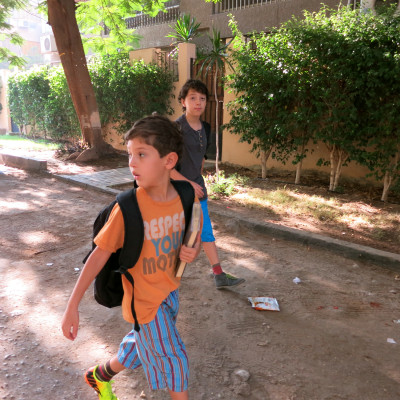 X and T, walking to school in Cairo on their first week.