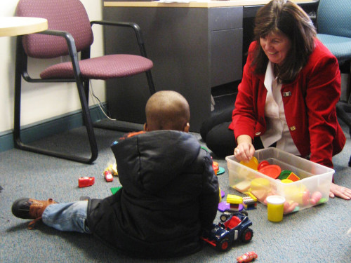 Denise Qualey, managing director at Kids in Crisis, and a former resident play with gifts from the TODAY Show Toy Drive