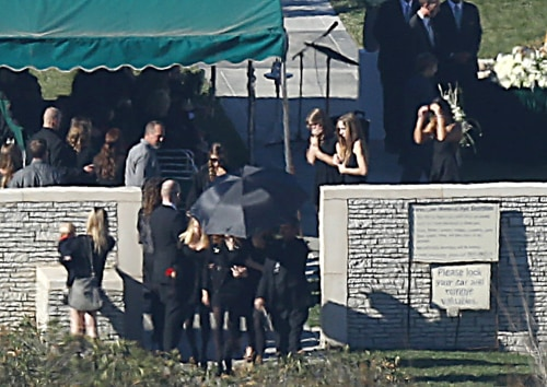 Friends and family gather at Hollywood's Forest Lawn Cemetery for Paul Walker's private funeral.