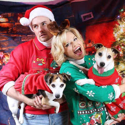 "An image from Megan Hilty and husband Brian Gallagher's holiday card, which they joke is called the ""Ugly Sweater Awkward Christmas Photo."""