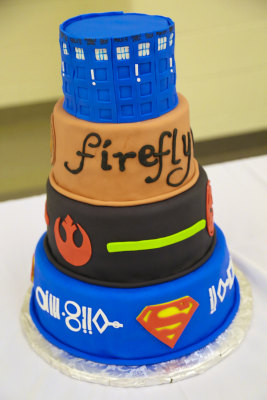 The cake, decked out with details from their favorite pop culture moments.