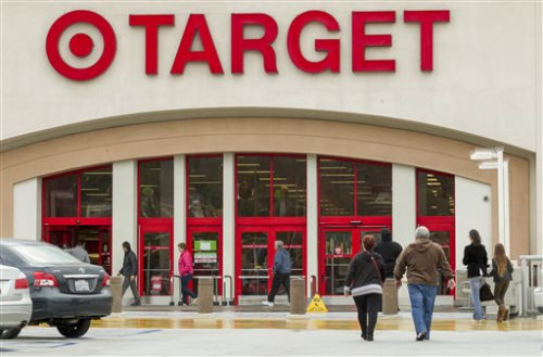 Shoppers arrive at a Target store in Los Angeles on Thursday, Dec. 19, 2013. Target says that about 40 million credit and debit card accounts may have...