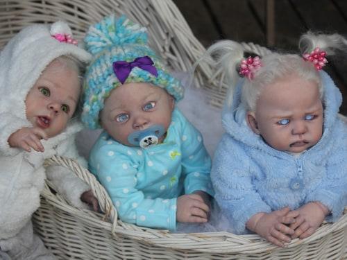 Oh look, sweet little bab-- aaaaiiiieeeeee! Reborn vampire and zombie baby dolls mix cute with creepy.