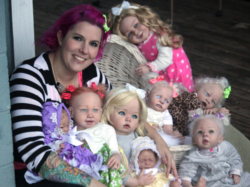 Mama and her monsters: Artist Bean Shanine, with some of her vampire and zombie reborn dolls.