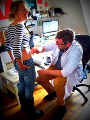 Author Dana McMahan prepares for her tattoo with Sailor Roman in his Paris apartment.