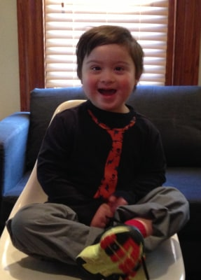 Five-year-old Milo Castillo has lots of friends in preschool and loves to give hugs.