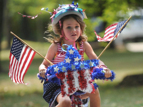 Emma-Cruz Jerrolds, 4, in her neighborhood's Fourth of July parade last year.