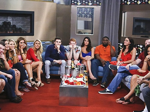"""Image: The """"Big Brother"""" houseguests sit together."""