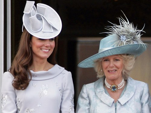 Catherine, Duchess of Cambridge and Camilla, Duchess of Cornwall stand on the balcony of Buckingham Palace during the annual Trooping the Colour Cerem...