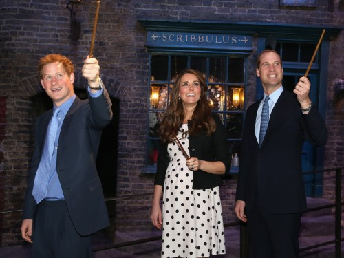 LONDON, ENGLAND - APRIL 26: Prince Harry, Catherine, Duchess of Cambridge and Prince William, Duke of Cambridge raise their wands on the set used to d...