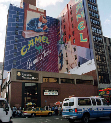 The RJ Reynolds Tobacco Co. said July 10 that it will retire the controversial Joe Camel advertising character seen here on the side of a building in ...