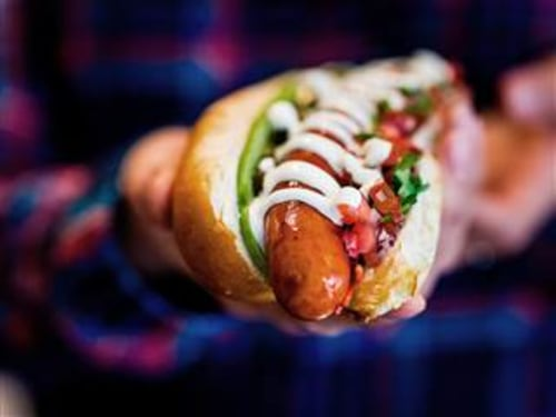 Bubbledogs, a new restaurant in London offers the humble hotdog paired with Champagne. It's part of a trend in the city for upmarket fast food