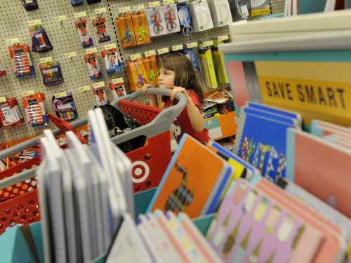 Five-year-old Millie Tomlin rests her chin on the shopping cart at Target in Lynchburg, Va., last August as her mom shops for her. as her mother picks...