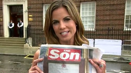 Natalie Morales holds up the U.K. newspaper The Sun, which changed its header in honor of the baby.