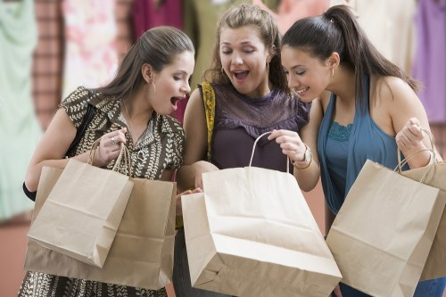 Multi-ethnic teenaged girls looking in shopping bag. stock, shopping, jealousy, mall, shop, girls, teen