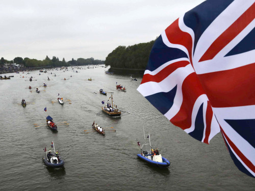 Pleasure boats of all shapes and sizes muster on the River Thames, in celebration of the Queen's Diamond Jubilee, near Putney Bridge in London June 3,...