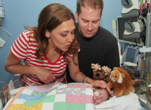 In this photo provided by the office of U.S. Rep. Jaime Herrera Beutler, Herrera Beutler, left, is seen with her husband, Dan Beutler, and their baby,...