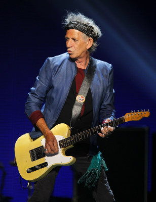 "Keith Richards of British rock band The Rolling Stones performs during their ""50 & Counting"" worldwide tour in Anaheim, California May 18, 2013. REUTE..."