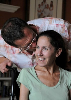 Susan Spencer-Wendel gets a kiss from her husband of 21 years and her full-time caregiver, John Wendel.