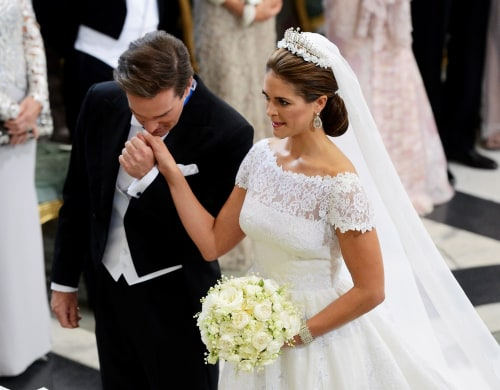 Christopher O'Neill kisses the hand of Princess Madeleine of Sweden at the alter in the Royal Chapel during their wedding ceremony in Stockholm.