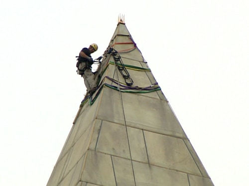 To gain access, workers take a 491-foot ride on a hoist.