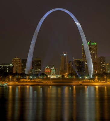 A vertical high dynamic range image of St. Louis and the Gateway Arch reflected in the Mississippi River, Mississippi, United States. (Photo by: MyLou...