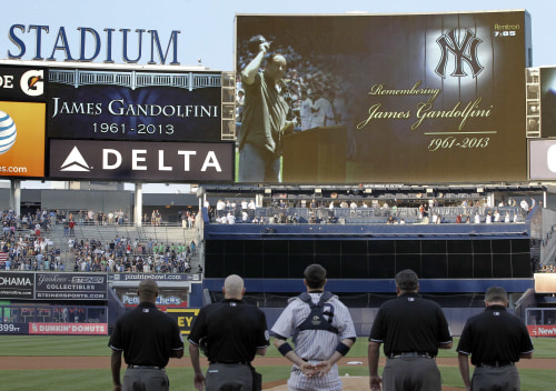 Image: A moment of silence is observed for actor James Gandolfini by the New York Yankees.