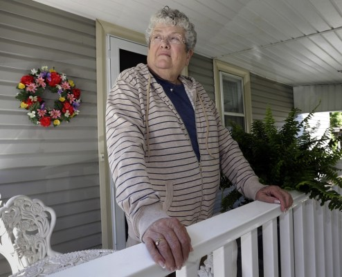 Former school bus monitor Karen Klein stands on the porch at her home in Greece, N.Y.