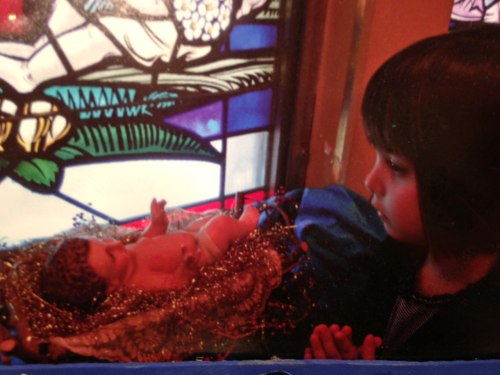 Paloma Duffy, 4, prays to the baby Jesus.