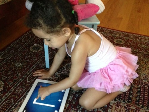 Keesha Beckford's daughter's favorite video on the iPad is 12 minutes long -- just enough time to get her hair done.