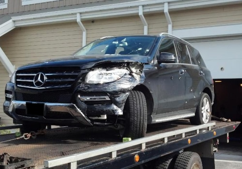 In this photo obtained by NBC News, a tow truck delivers a bullet-riddled black Mercedes SUV to police headquarters in Watertown, MA, on Friday aftern...