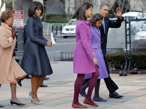 President Barack Obama, accompanied by his daughters Sasha and Malia, first lady Michelle Obama and mother-in-law Marian Robinson, waves as they arriv...