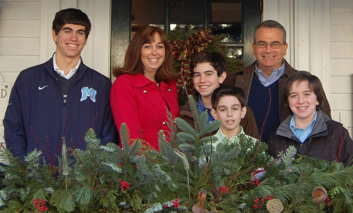 More kids, less stress? Karen Hobert Flynn, with her husband and four sons, says going from three to four was an easier transition than going from one to two or two to three kids.