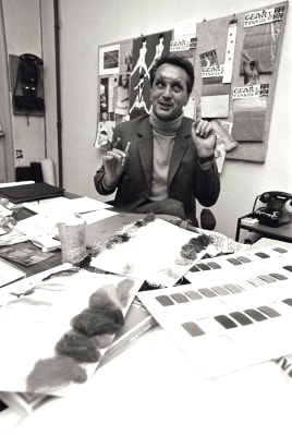 Fashion designer Ottavio Missoni, sitting at his desk in his study, full of sketches and sheets in Italy, 1968.