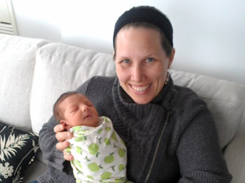 Doula Megan Davidson with one of the babies she helped deliver.