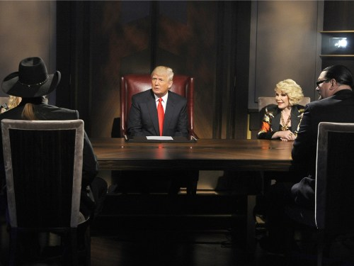 "Donald Trump sizes up the ""All-Star Celebrity Apprentice"" finalists while boardroom advisor Joan Rivers looks on."