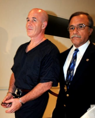 A handcuffed Kerik is led away at the Bronx Hall of Justice after testifying at a perjury trial for two of his former friends. Kerik served time in prison for tax evasion and lying to the White House.