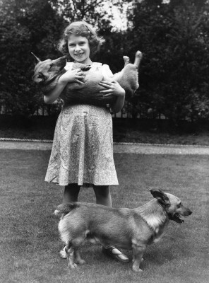 Image: In July 1936, 10-year-old Princess Elizabeth played with two Corgis at her home in London.