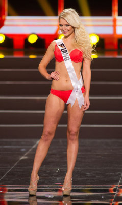 This photo provided by the Miss Universe Organization shows Lotta Hintsa, Miss Finland 2013, competes in the swimsuit competition during the Prelimina...