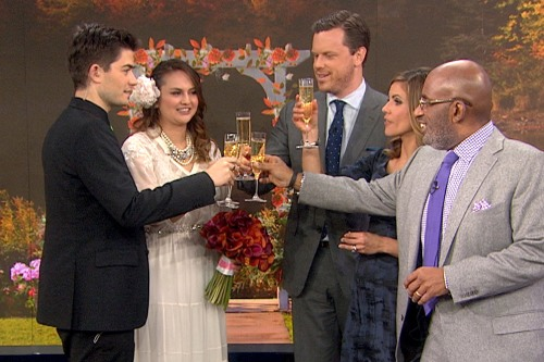 The newlyweds and their TODAY wedding guests toast to their lucky day.