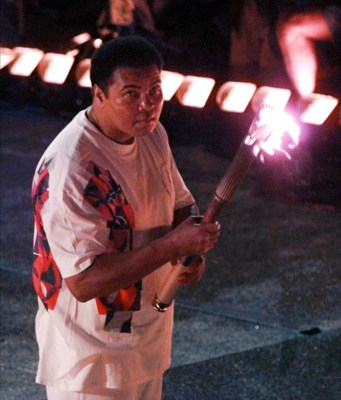 Ali, lighting the Olympic torch in 1996. He was diagnosed with Parkinson's disease in 1984.