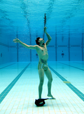 Australian sword swallower Cheyne Hultgren successfully sets a new Guinness Book World Record for most swords swallowed while underwater, at the Sydney Aquatic Centre in Sydney.