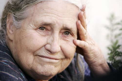 (FILES) In a file picture taken on October 11, 2007 British writer Doris Lessing holds her head in her hands outside her home in north London, as she ...
