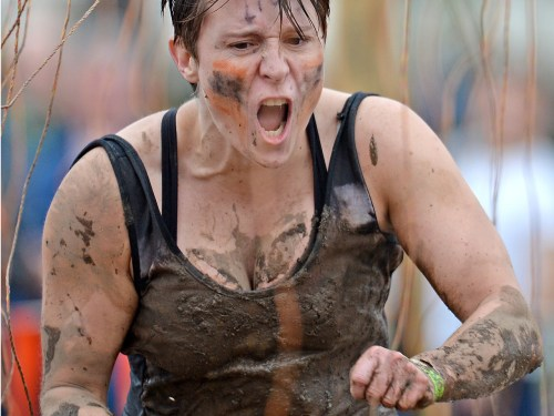 Participants take part in the Tough Mudder endurance event at Dalkieth Country Estate on August 24, 2013, in Edinburgh, Scotland.