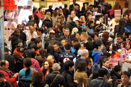 Why do people join the Black Friday crowds, like these Macy's shoppers last year? Some are after deals, while others see it as a bonding experience.