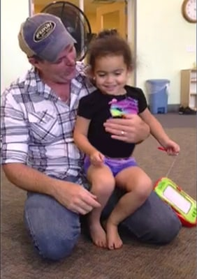 Matt Capobianco sits with baby Veronica in Tahlequah, Oklahoma, in this handout photo courtesy of the Capobianco Family.