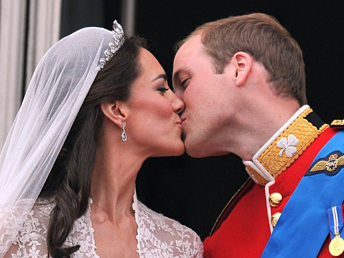Prince William and his wife Kate Middleton, Duchess of Cambridge, kiss on the balcony of Buckingham Palace in London, following their wedding on April...