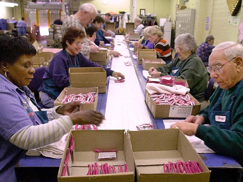 Workers in the senior section package cosmetics on the assembly line at the Bonne Bell cosmetics factory in Lakewood, Ohio, in this 2001 file photo. A new Wells Fargo survey found a large percentage of Americans expect to work until they die or get too sick to work.